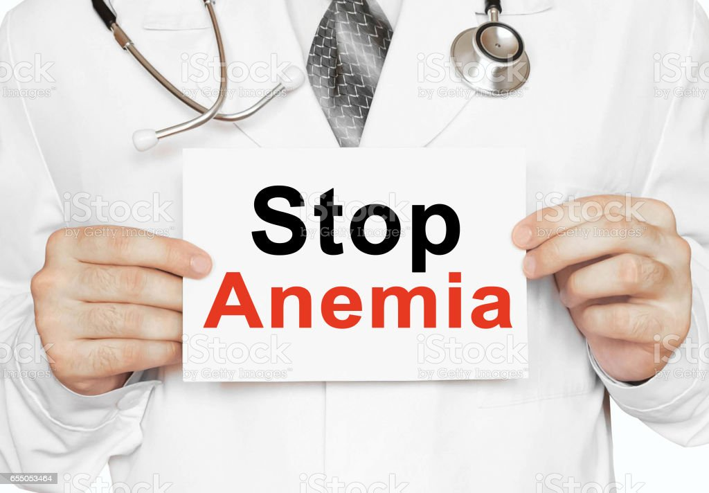 Stop Anemia card in hands of Medical Doctor stock photo