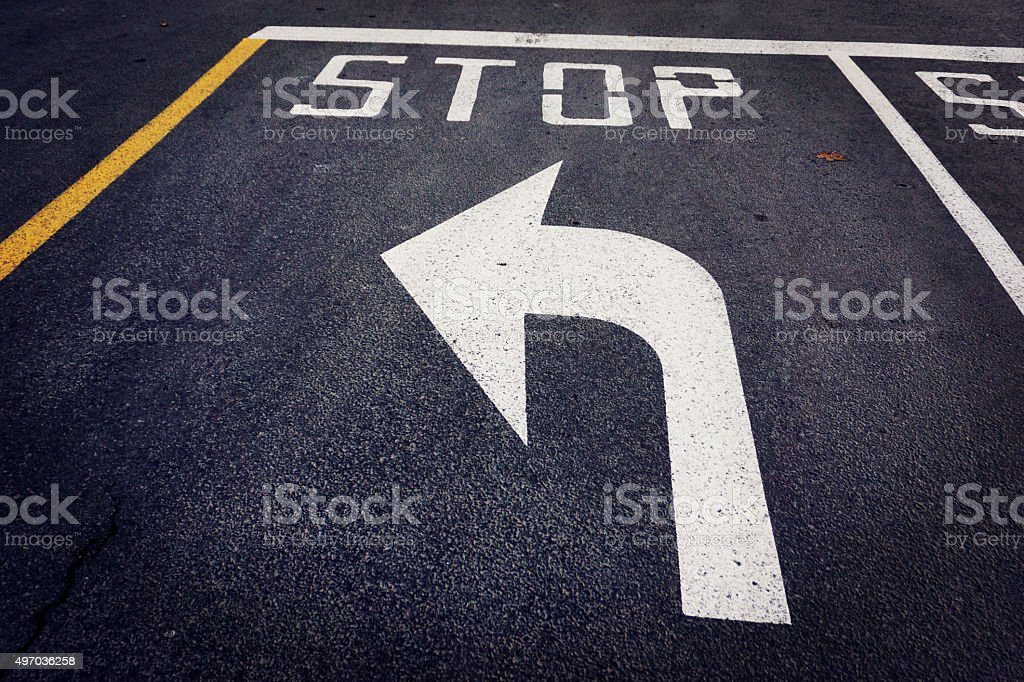 Stop before turn left arrow on street stock photo