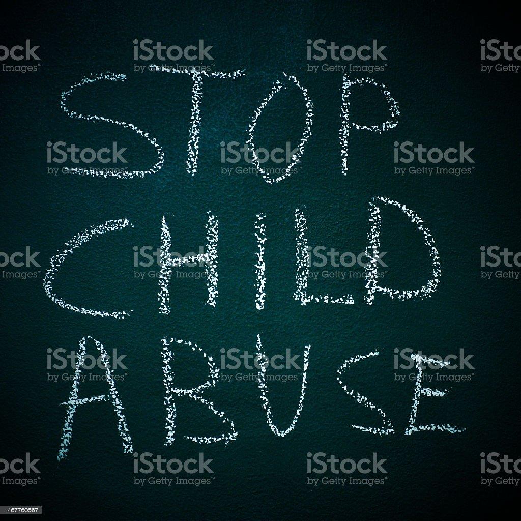 Stop child abuse handwritten in chalk on blackboard stock photo