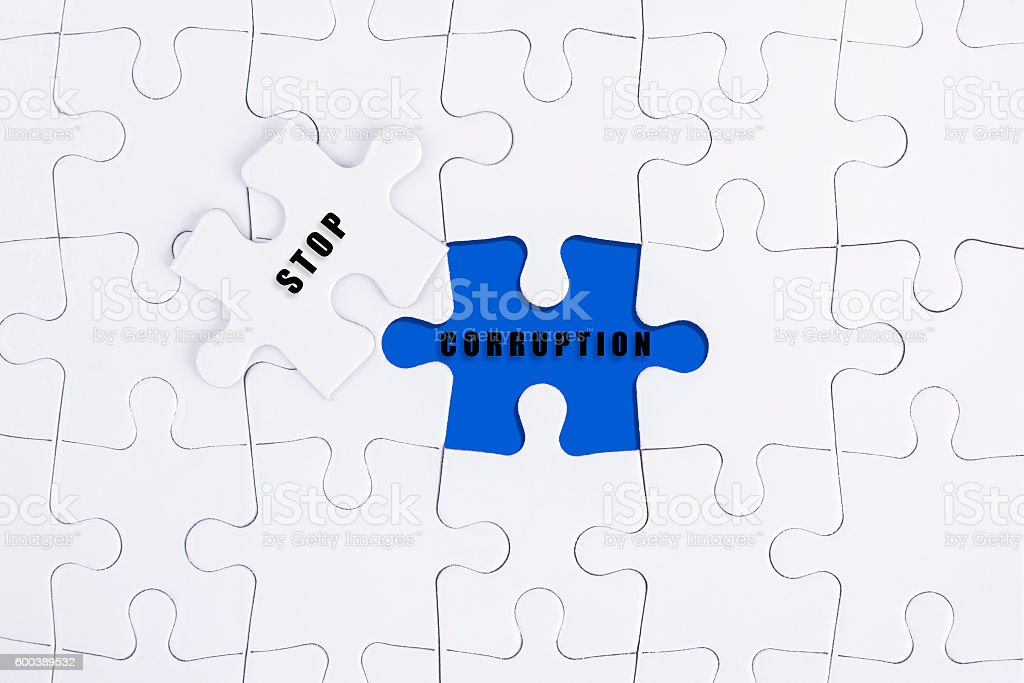 Stop Corruption concept on missing puzzle. stock photo