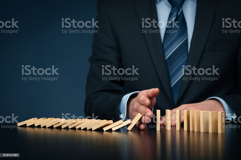 Stop domino effect and risk management stock photo