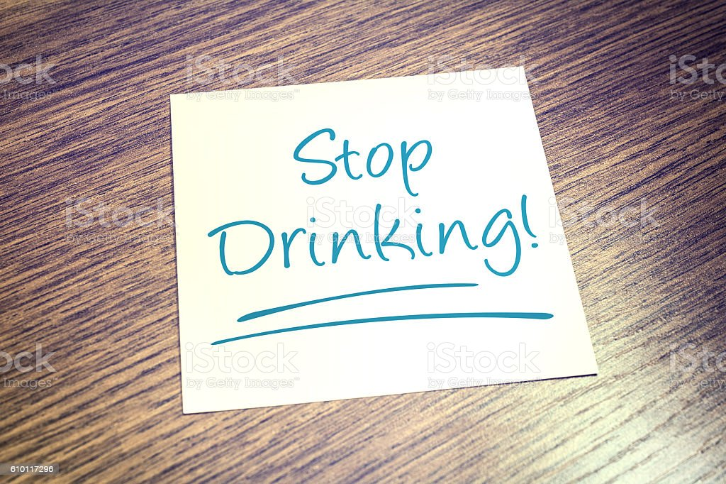 Stop Drinking Reminder On Paper On Wooden Table stock photo