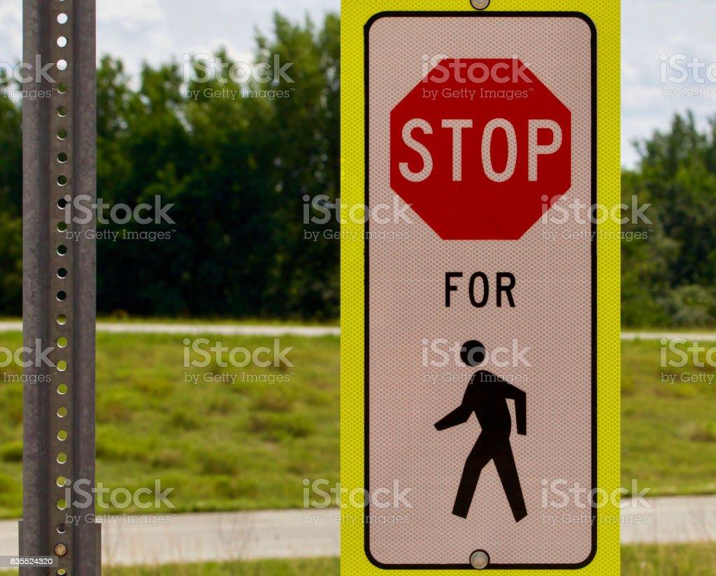 Stop for pedestrian stock photo