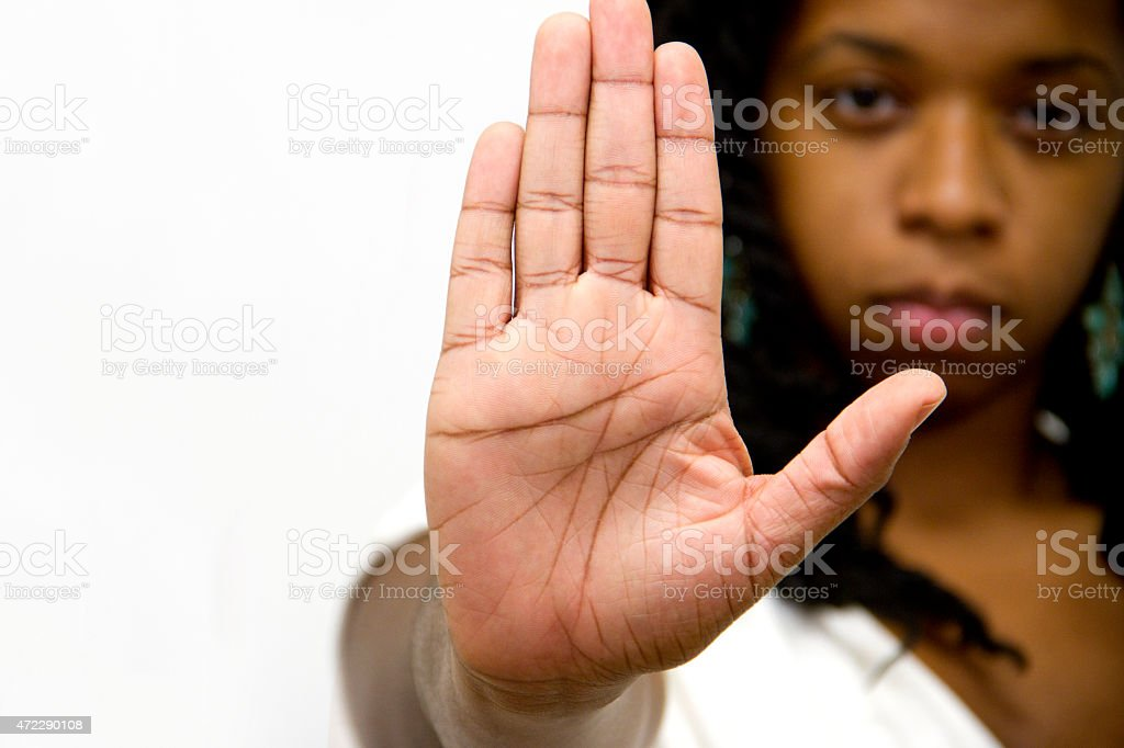 Stop Gesture Of Woman Hand  Sign Serious Facial Expresion stock photo