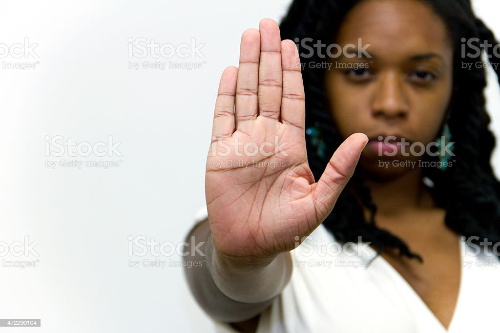 Stop Gesture Of Woman Hand with a Serious Facial Expresion stock photo