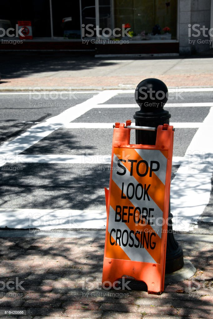 """Stop Look Before Crossing"" Warning sign at crosswalk, Hyannis, Cape Cod, New England, Massachusetts, USA stock photo"