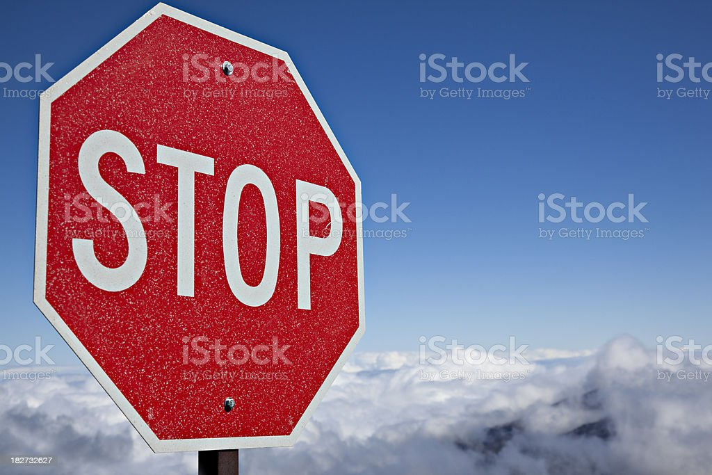 stop sign above the clouds stock photo