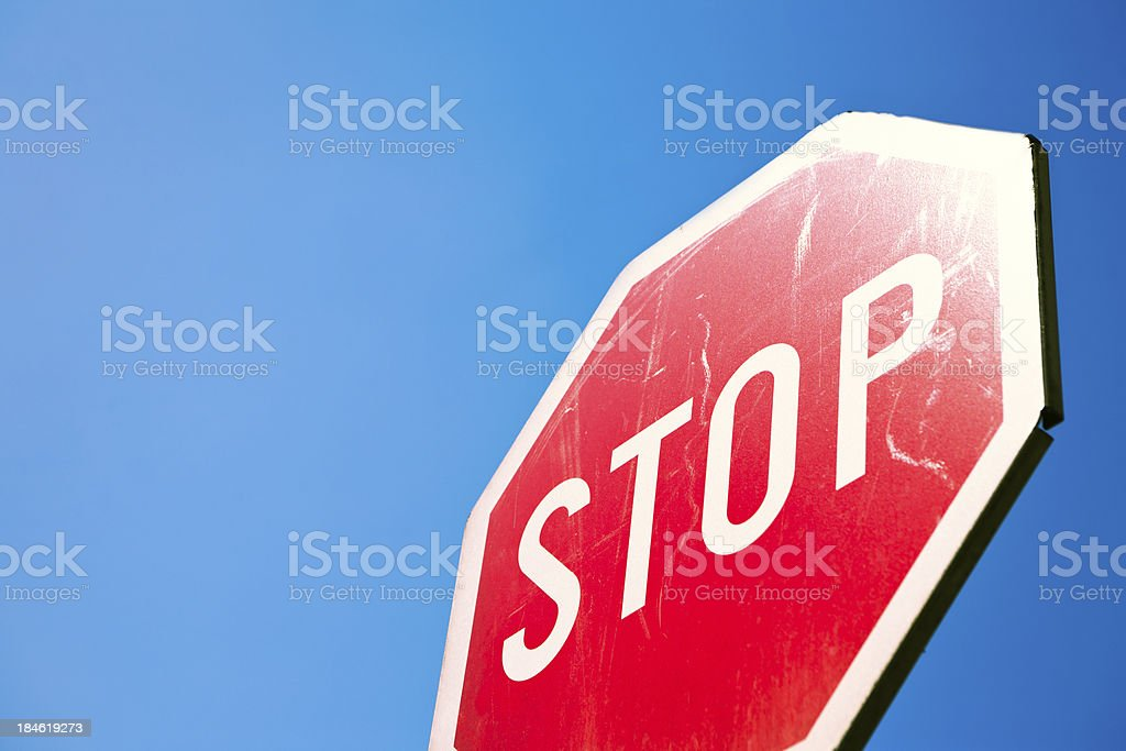 Stop sign against deep blue sky royalty-free stock photo