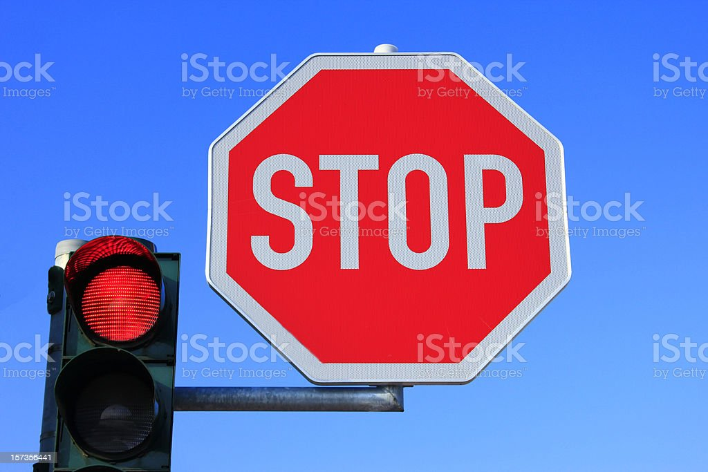 Stop sign and red light stock photo