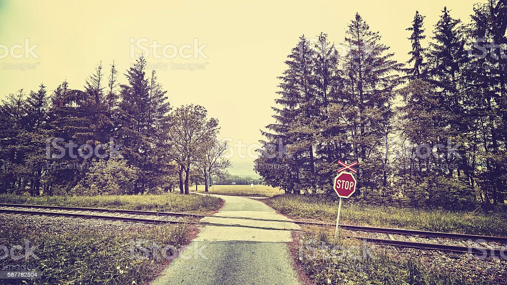 Stop sign at railway crossing in a rural landscape. stock photo