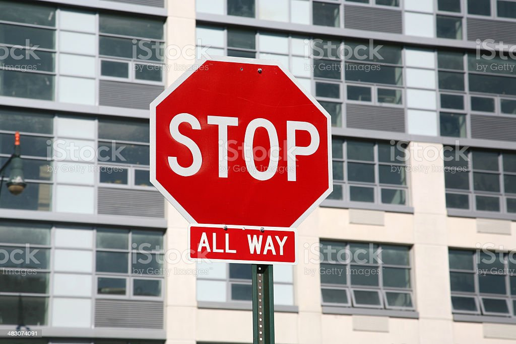 Stop Sign In Front Of Building stock photo