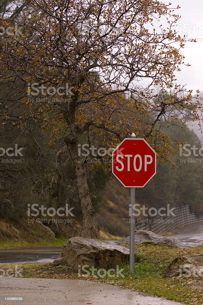 Stop sign in rain stock photo