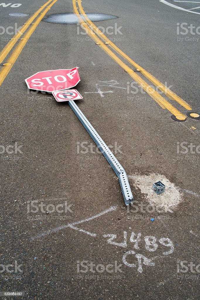 Stop sign knocked down stock photo