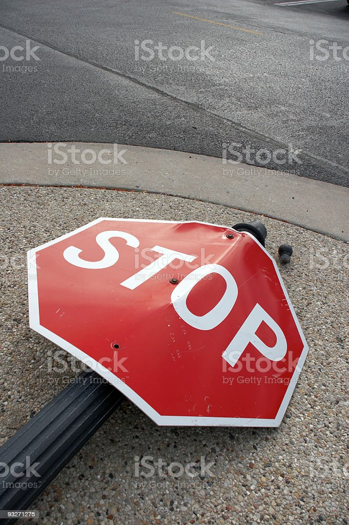Stop sign lying in the street as the result of an accident royalty-free stock photo