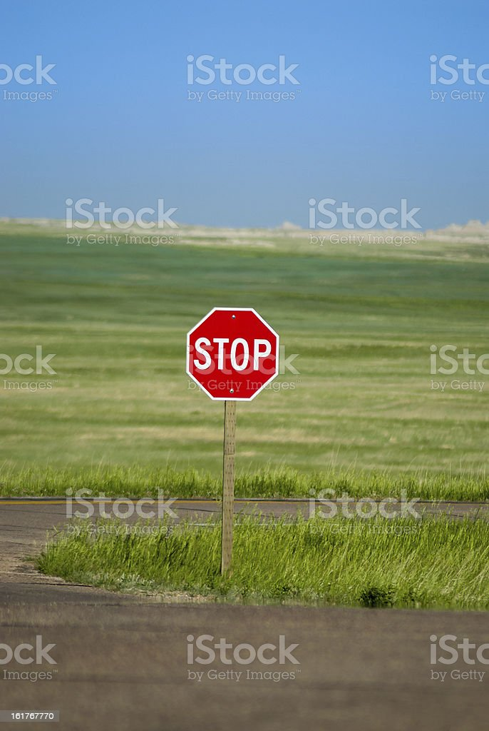 Stop sign on a rural road stock photo