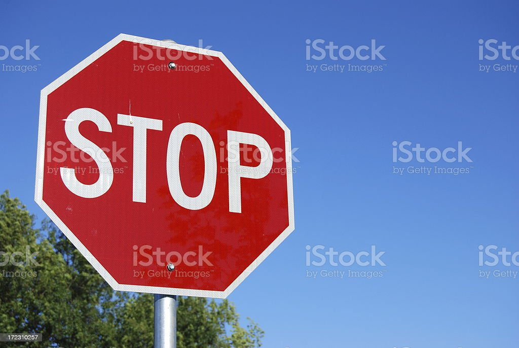 Stop sign on a street on a clear sunny day. royalty-free stock photo