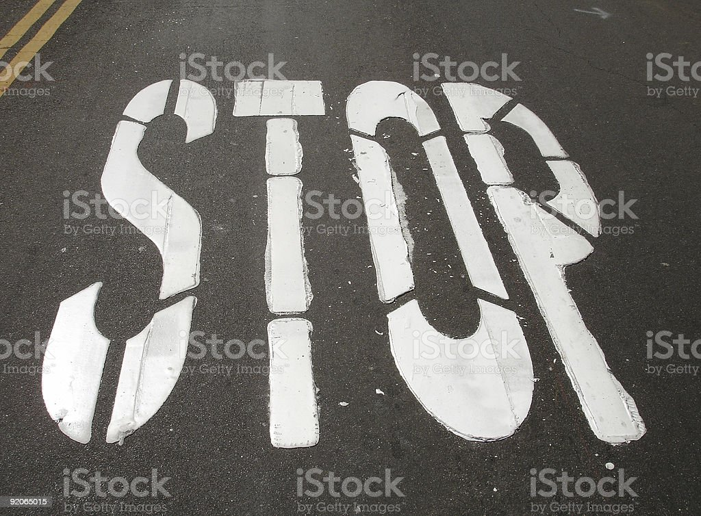 Stop sign on road stock photo