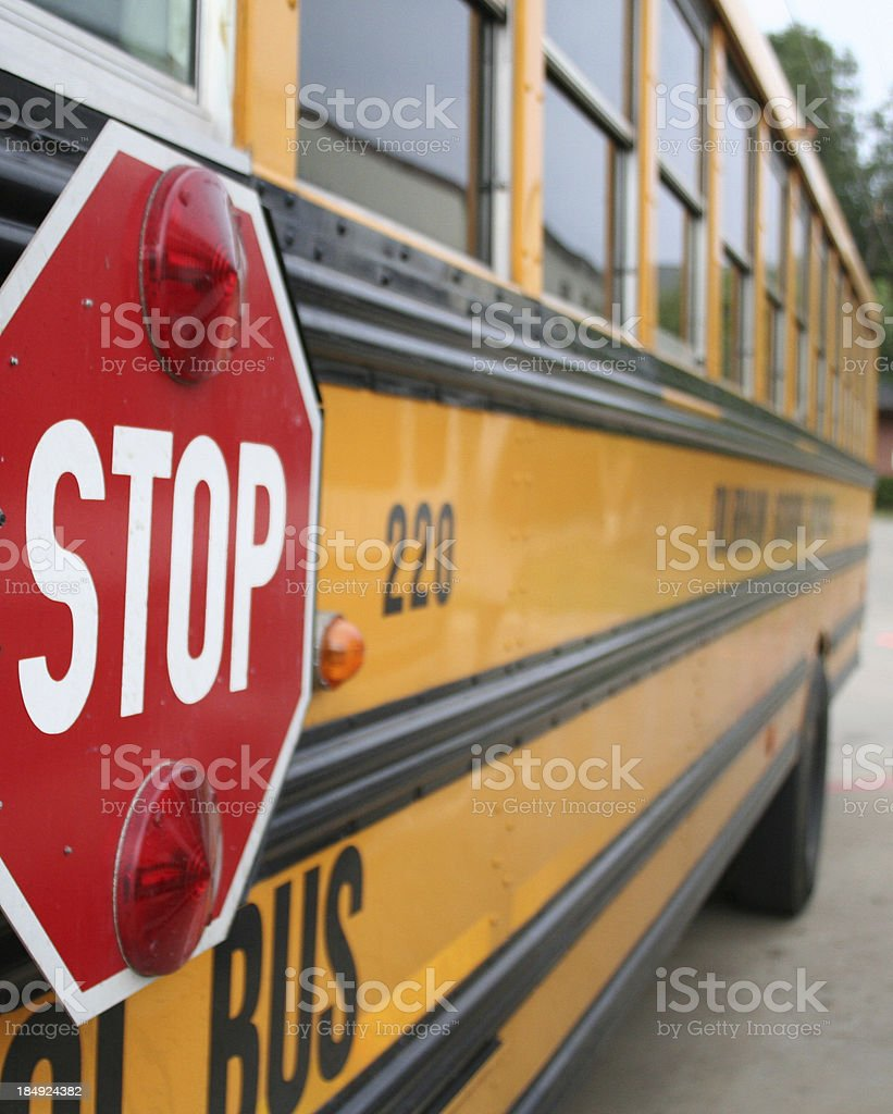 Stop Sign On The Side Of A Yellow School Bus stock photo