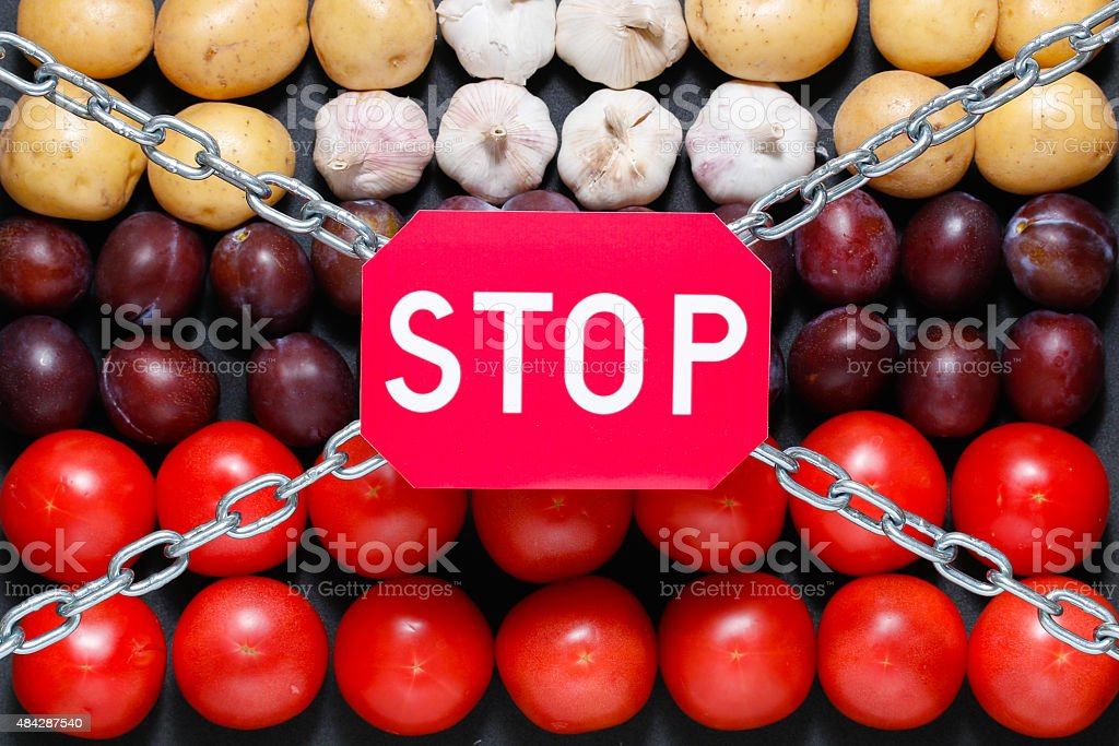 Stop sign on vegetables background stock photo
