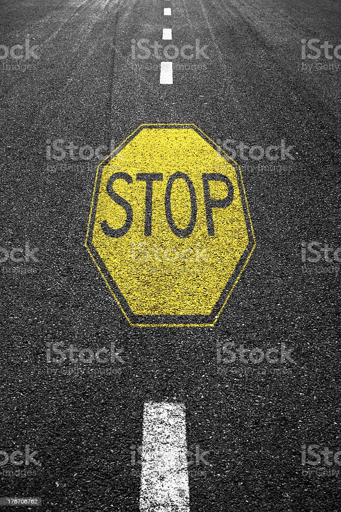 Stop sign painted on the asphalt. royalty-free stock photo
