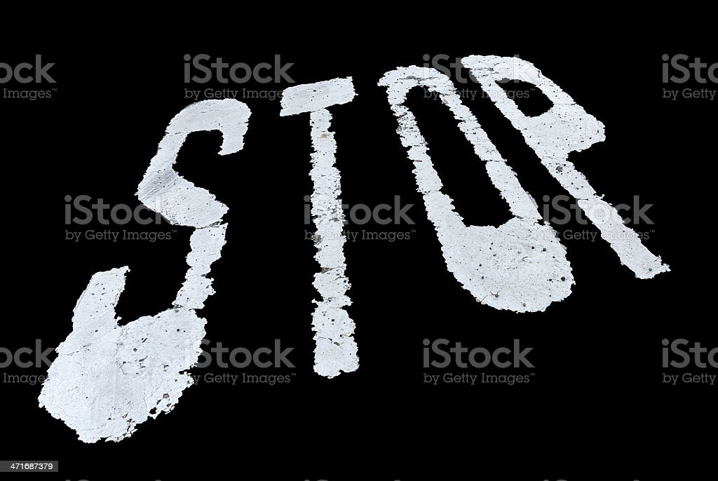 Stop sign painted on the wall isolated over black background royalty-free stock photo