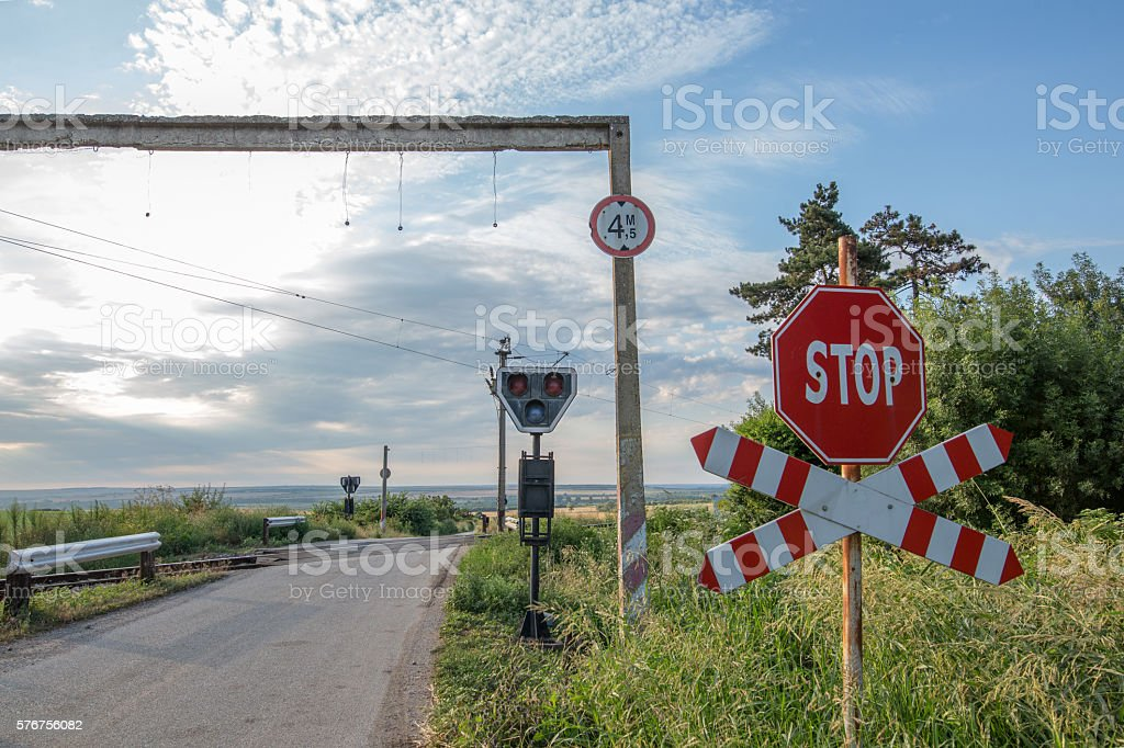 Stop sign warning for railway crossing stock photo