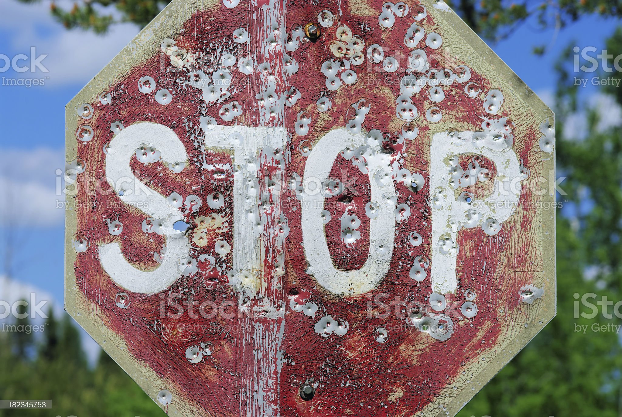 Stop Sign with Bullet Holes royalty-free stock photo