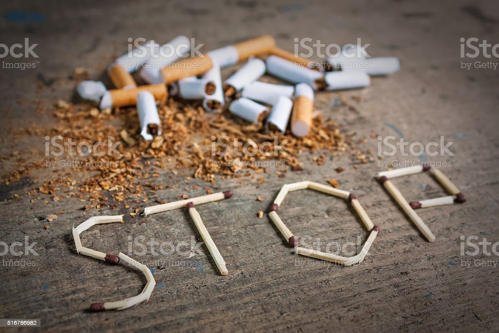 Stop smoking background with broken cigarettes stock photo