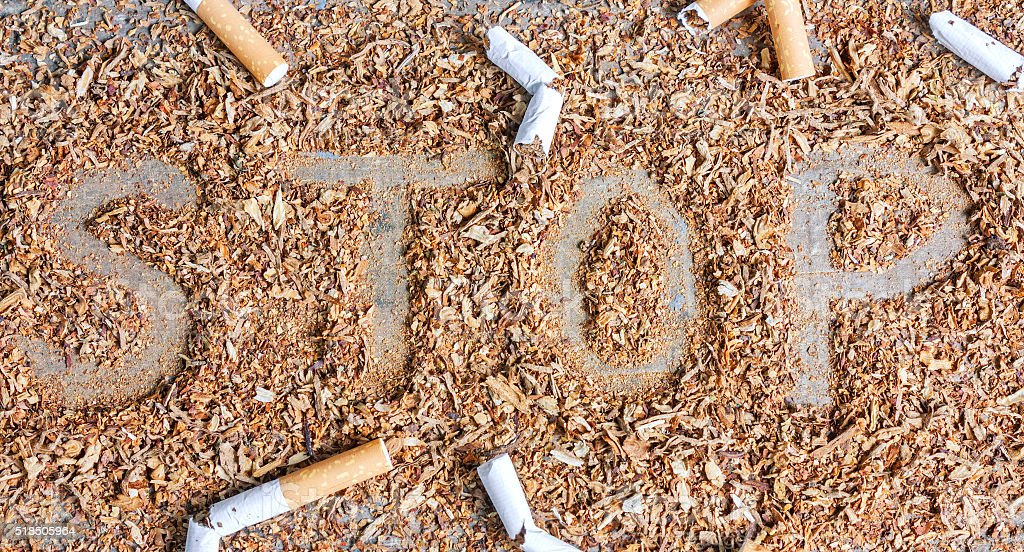 Stop smoking background with tobacco and cigarettes stock photo