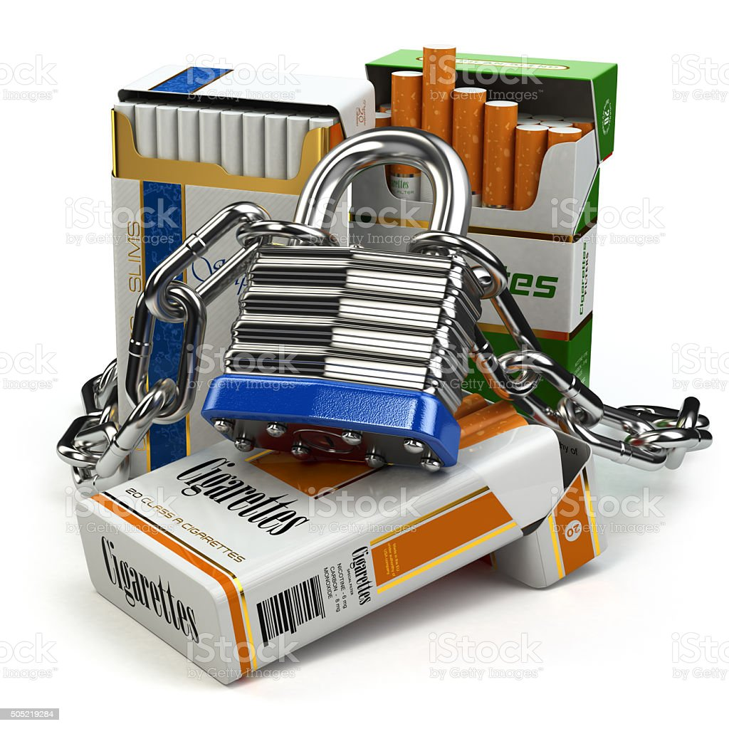 Stop smoking concept. Pack of cigarettes and lock with chain. stock photo