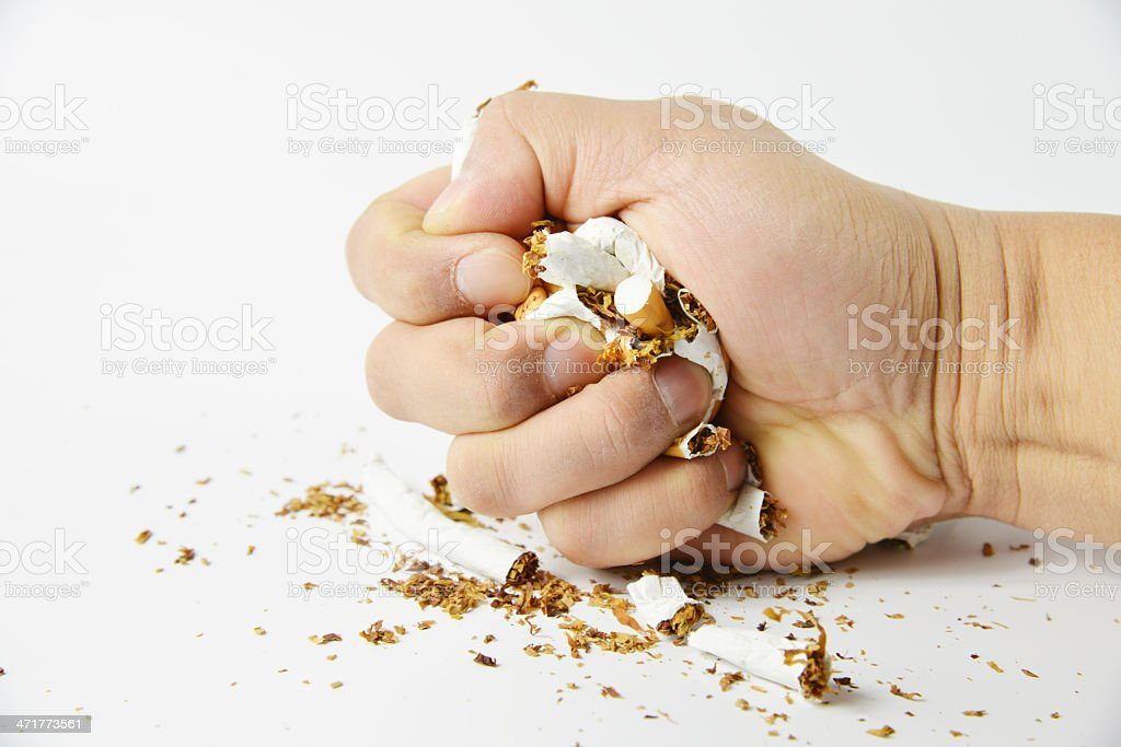 Stop smoking fist with crushed cigarettes royalty-free stock photo