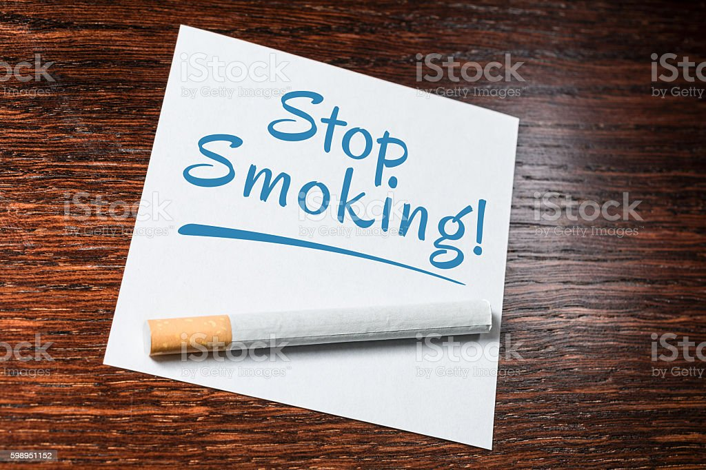 Stop Smoking Reminder With Cigarette On Wooden Shelf stock photo