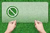 stop symbol message box with green grass background