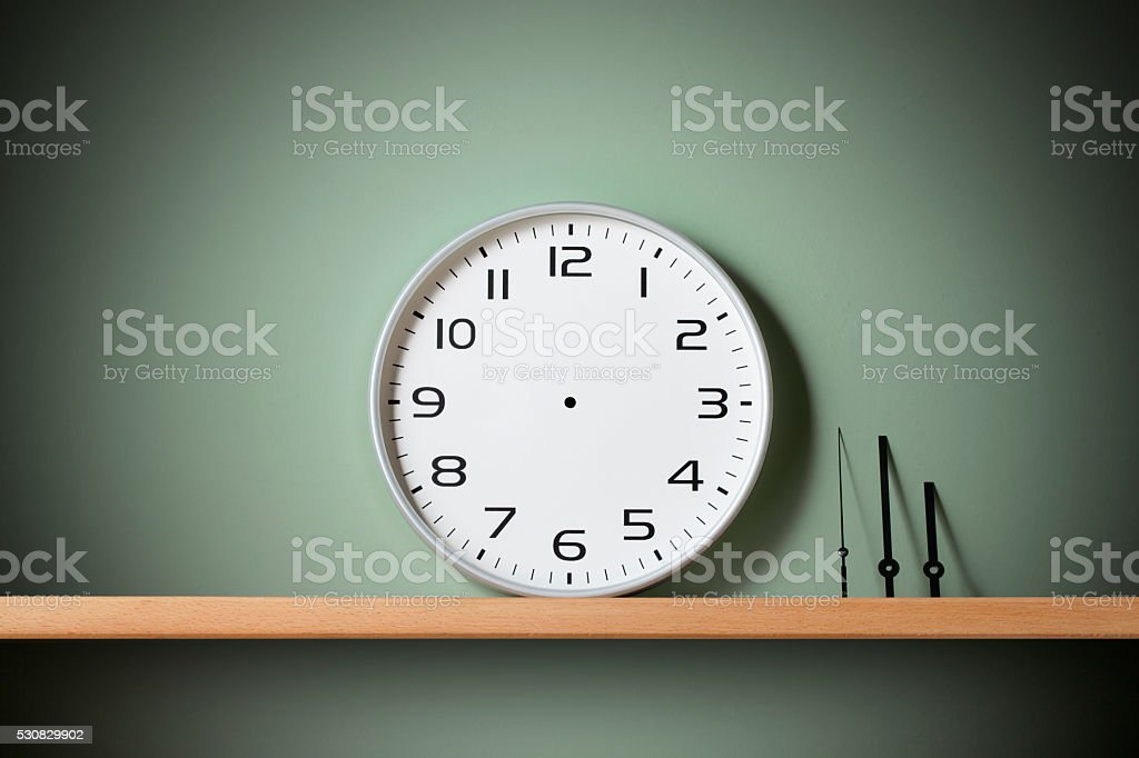 Stop time. Clock on the shelf. stock photo