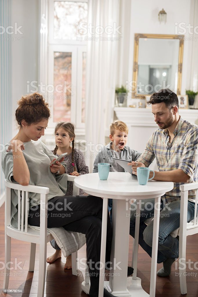 Stop using that, pay attention to us! stock photo