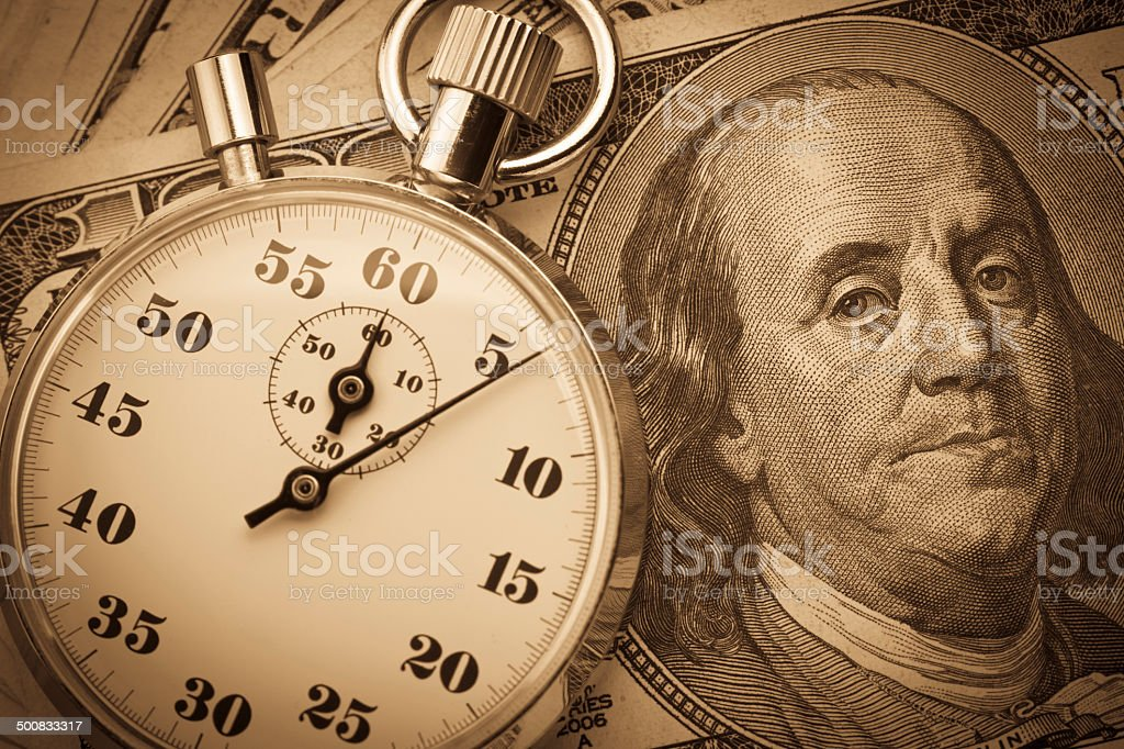 Stop watch and dollar stock photo