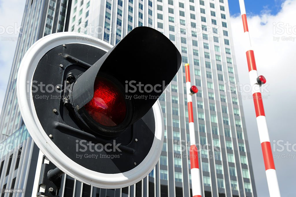 Stoplight in front of a high rise building royalty-free stock photo