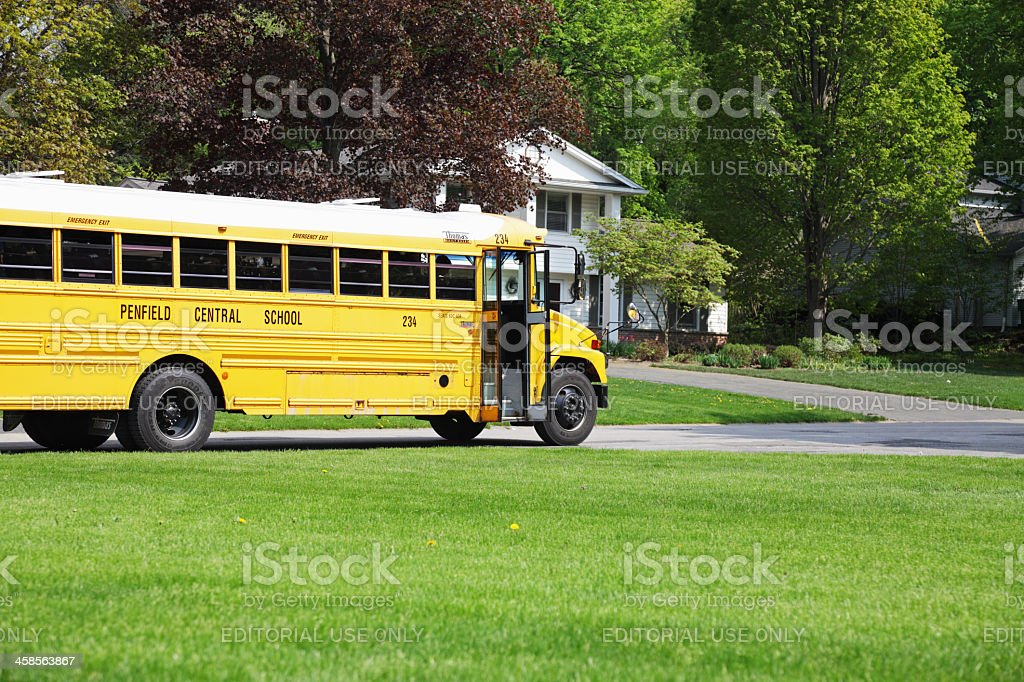 Stopped School Bus on Residential Street stock photo
