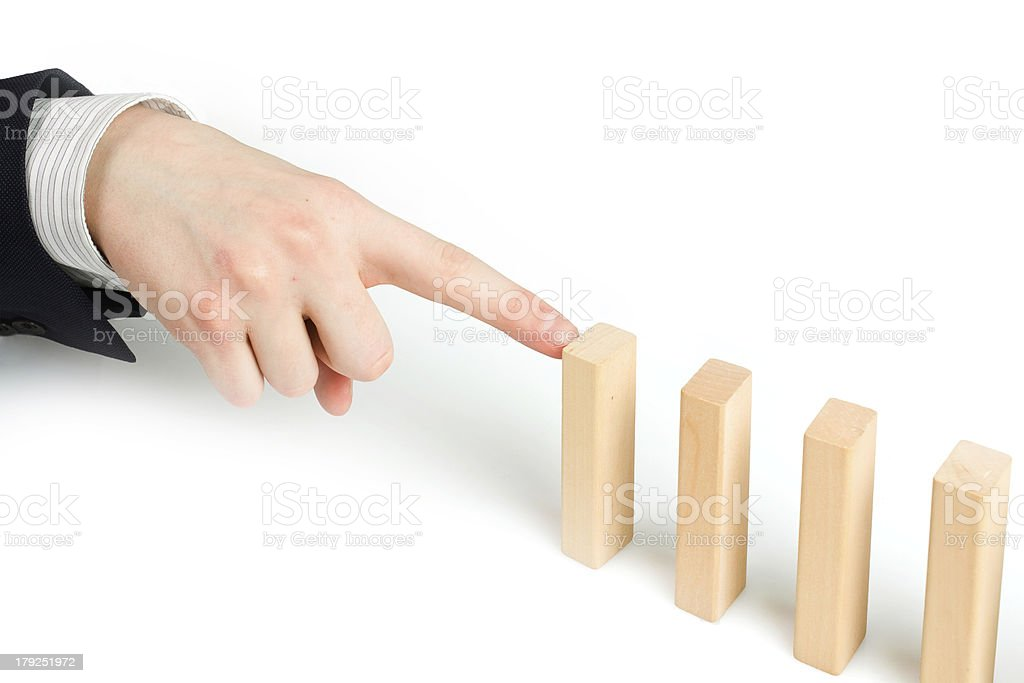 stopping the domino effect royalty-free stock photo