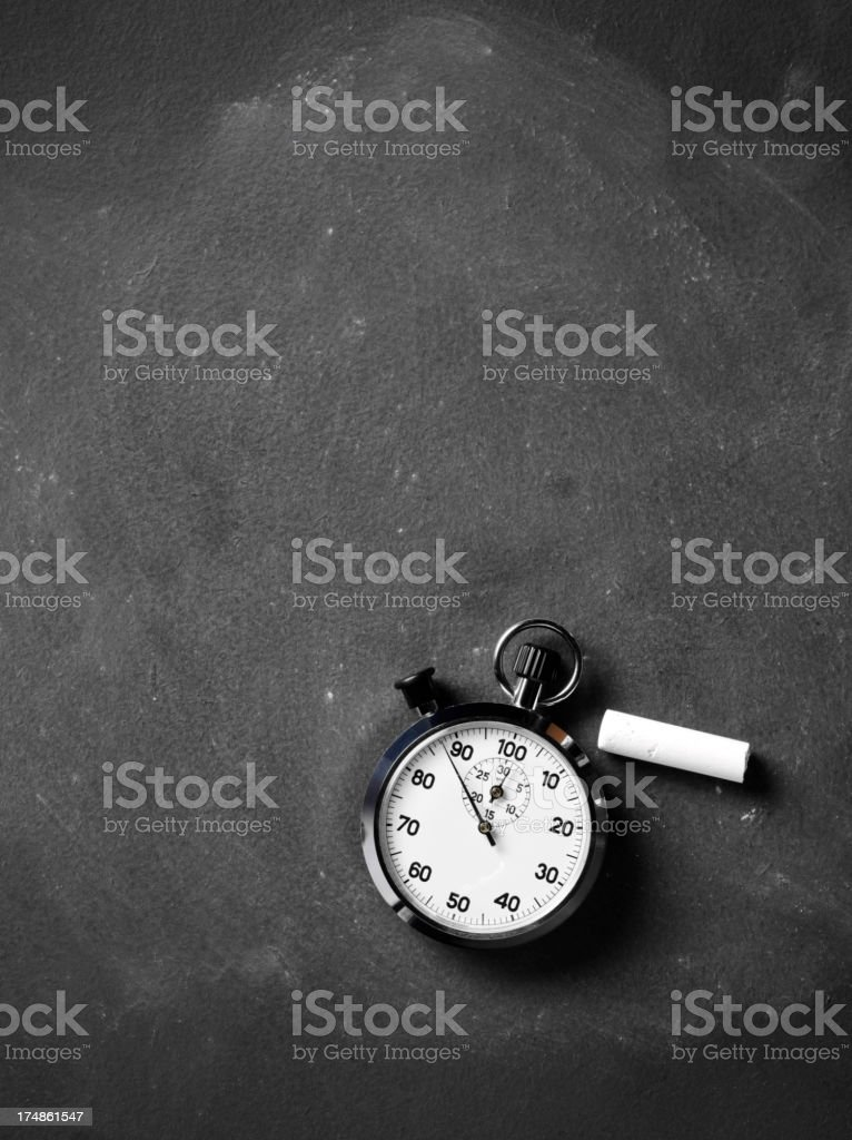 Stopwatch and Chalk on a Blackboard royalty-free stock photo