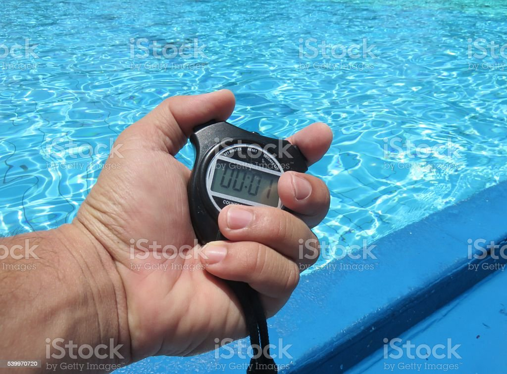 Stopwatch and swimming pool stock photo