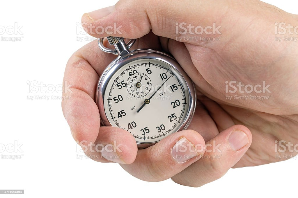 Stopwatch in hand. stock photo