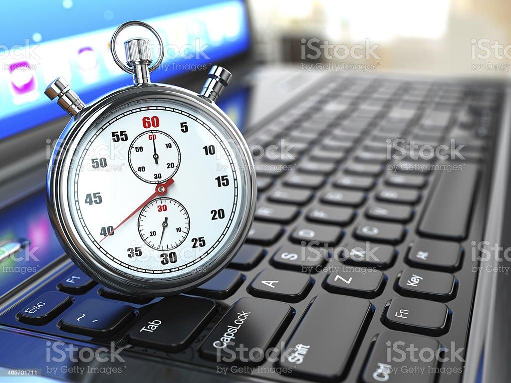 Stopwatch on laptop keyboard. stock photo