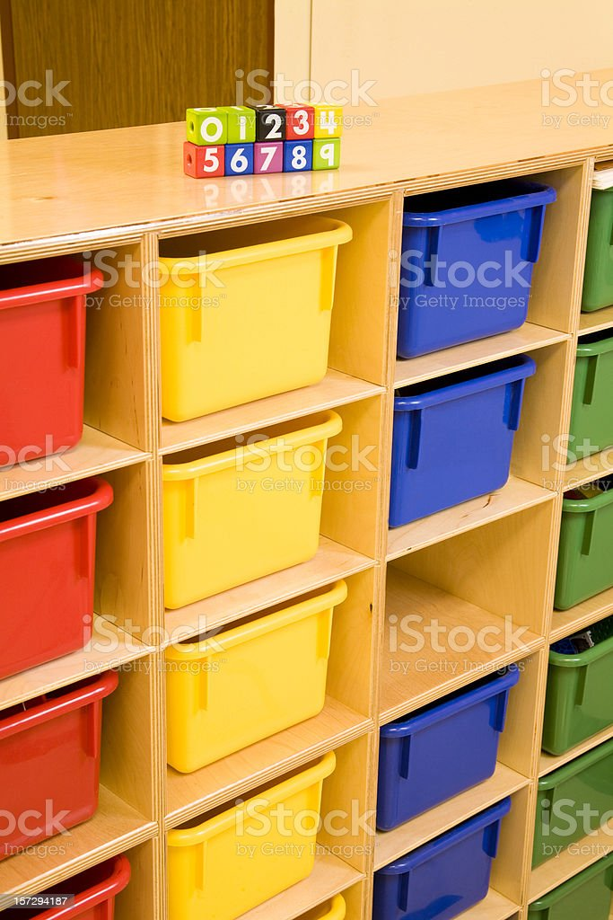 Storage bins for manipulatives in a kindergarten classroom royalty-free stock photo