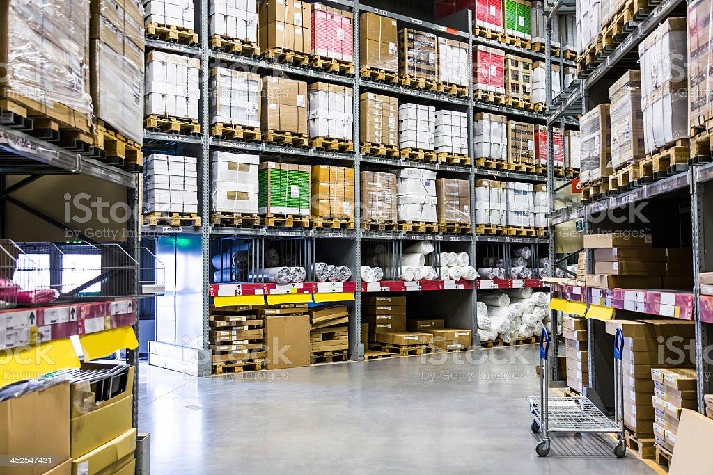 Storage boxes organized in warehouse stock photo