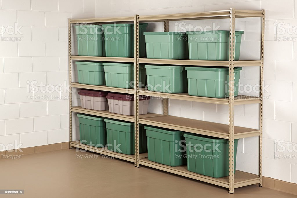 Storage Containers on a Shelf royalty-free stock photo