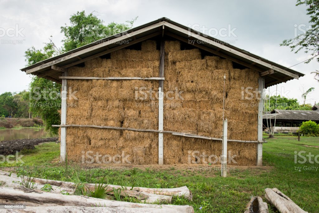 storage of straw bales stock photo