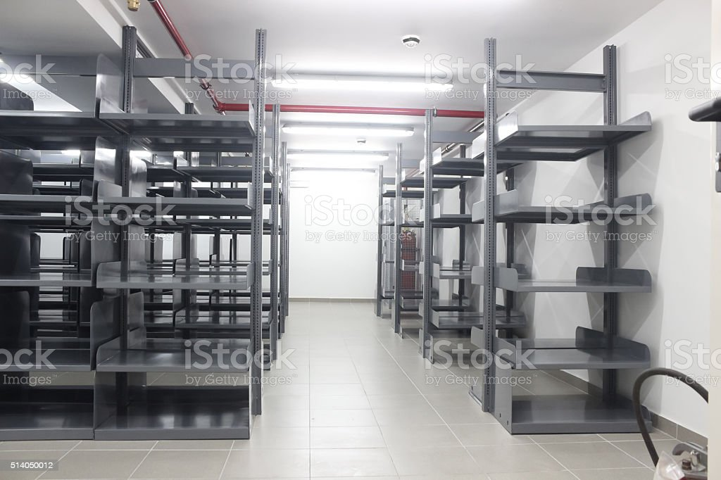 Storage room full of metal bookcases stock photo