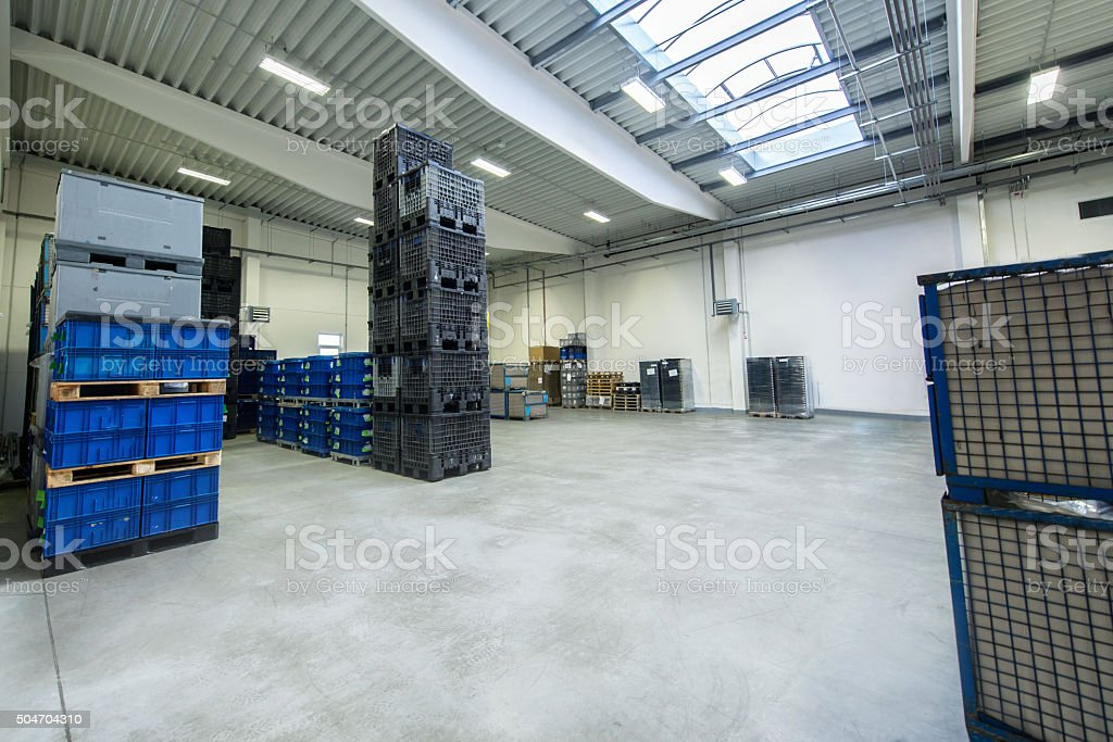 Horizontal image of modern new warehouse of large factory. The...