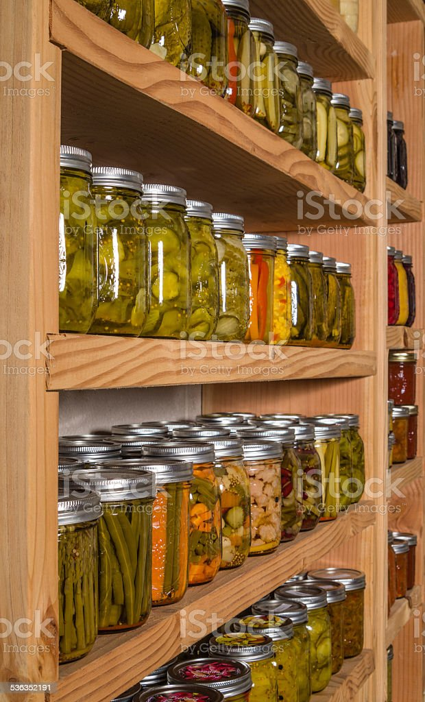 Storage shelves with canned goods stock photo